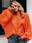 Pomarańczowy sweter oversize gruby warkocz z przodu 1