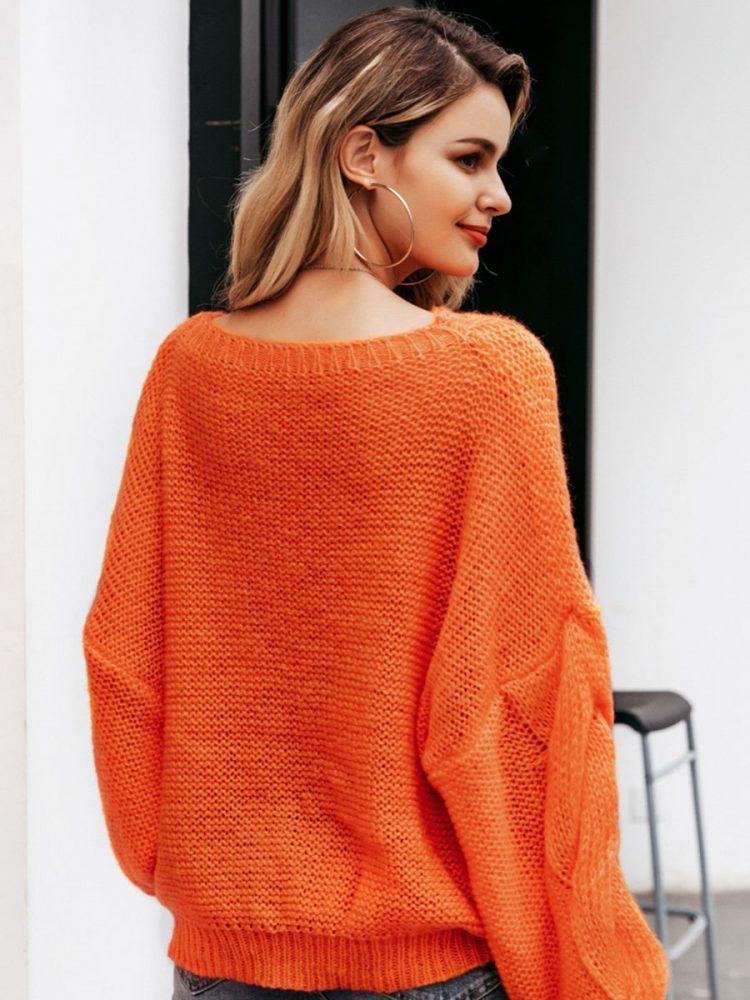 Pomarańczowy sweter oversize gruby warkocz z przodu 2