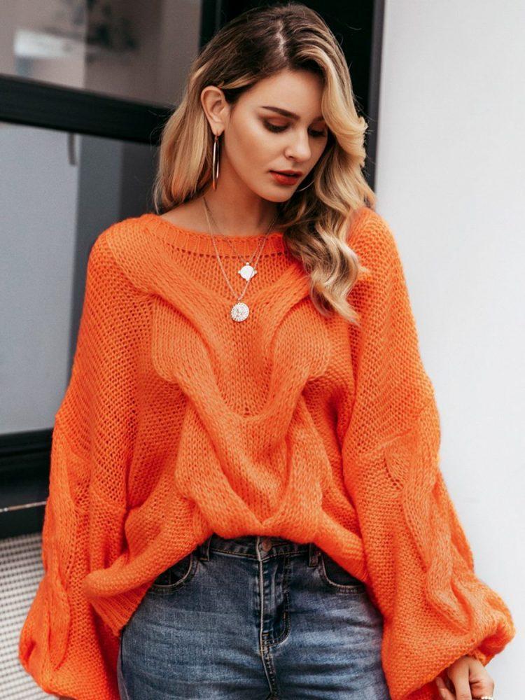 Pomarańczowy sweter oversize gruby warkocz z przodu 3