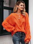 Pomarańczowy sweter oversize gruby warkocz z przodu 4