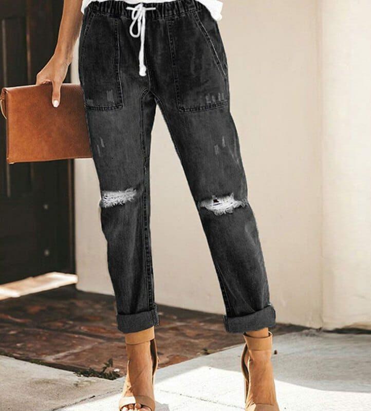 Damskie jeansy z przetarciami i wiązaniem w pasie w kolorze ciemny denim 1