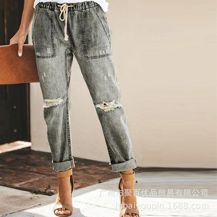Damskie jeansy z przetarciami i wiązaniem w pasie w kolorze ciemny denim 2