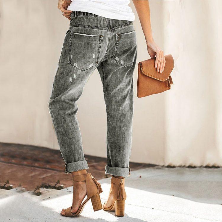 Damskie jeansy z przetarciami i wiązaniem w pasie w kolorze ciemny denim 3