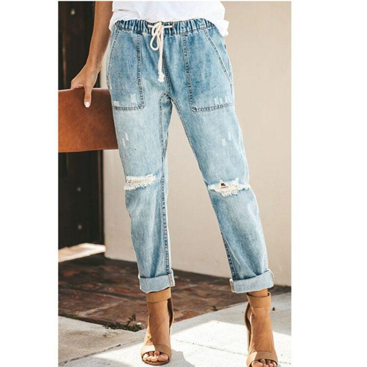 Damskie jeansy z przetarciami i wiązaniem w pasie w kolorze ciemny denim