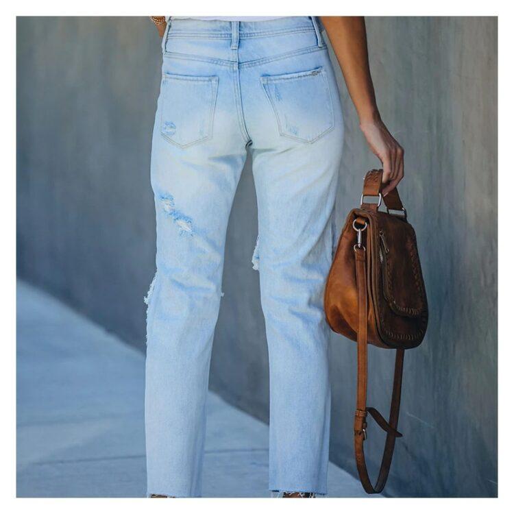 Jeansy spodnie z dużymi dziurami damskie w kolorze jasny denim 2