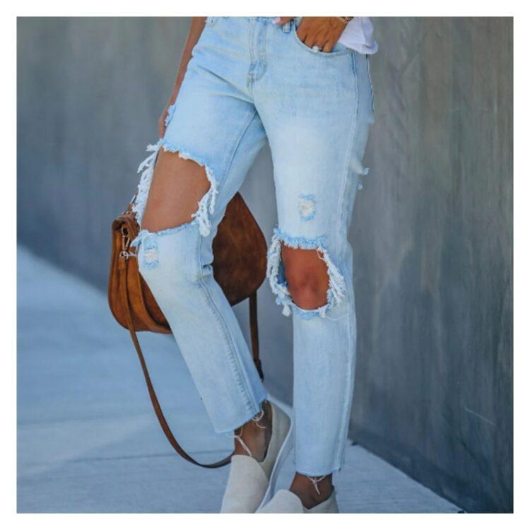 Jeansy spodnie z dużymi dziurami damskie w kolorze jasny denim 3