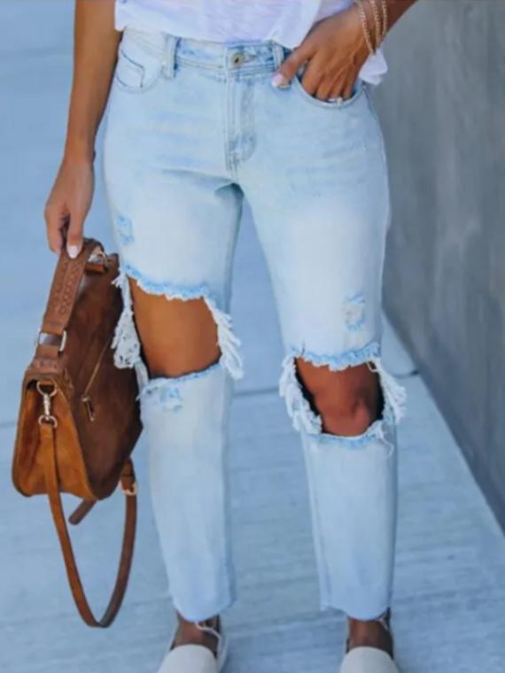 Jeansy spodnie z dużymi dziurami damskie w kolorze jasny denim