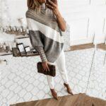 Obszerny sweter ala ponczo z golfem oraz bufiastymi rękawami
