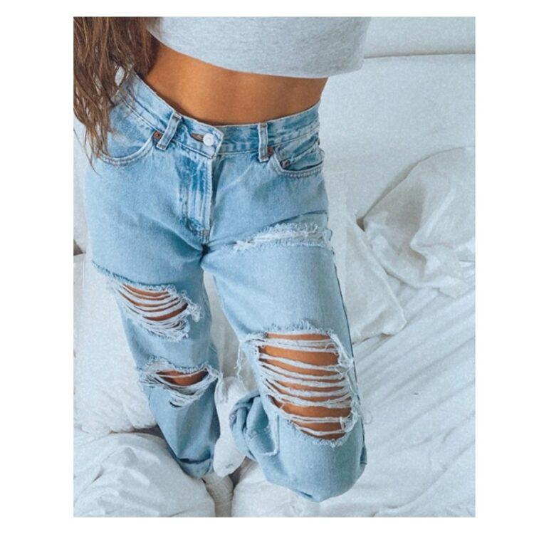 Spodnie jeansy z dziurami damskie w kolorze jasny denim typu rurki 3
