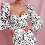 Biała sukienka w panterkę z bufiastymi rękawami 1