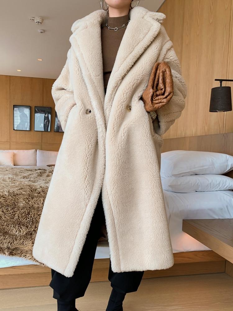 Obszerny kremowy płaszcz wełniany zimowy z wełny z alpaki