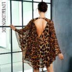 Rozkloszowana sukienka szyfonowa w panterkę z dekoltem v 1