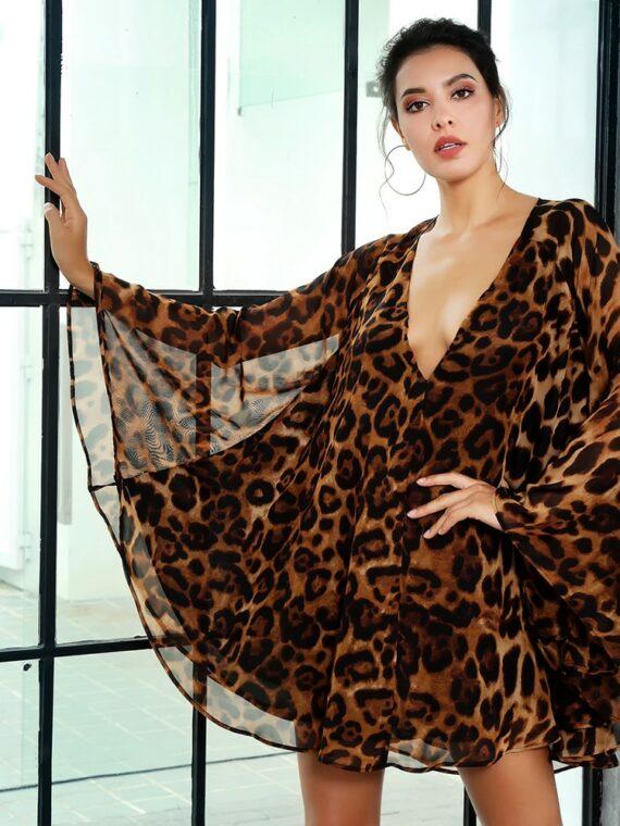 Rozkloszowana sukienka szyfonowa w panterkę z dekoltem v