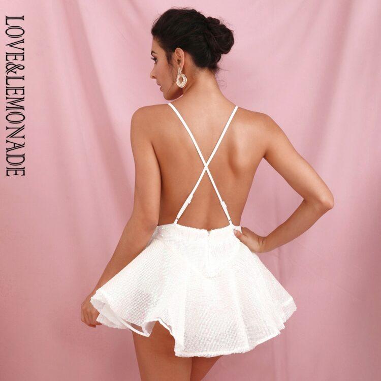 Biała sukienka rozkloszowana z tiulową halką mini 2