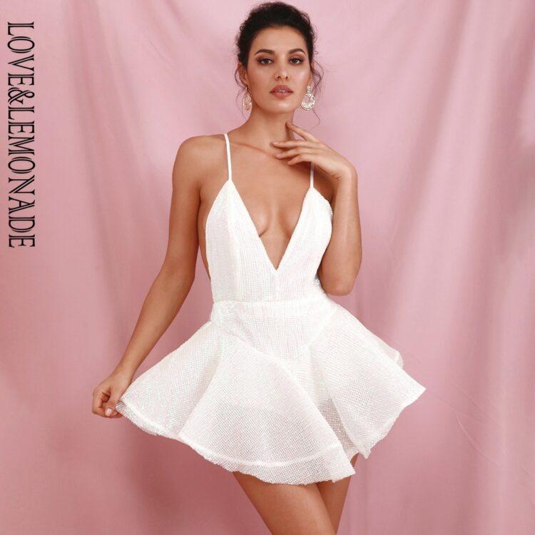 Biała sukienka rozkloszowana z tiulową halką mini