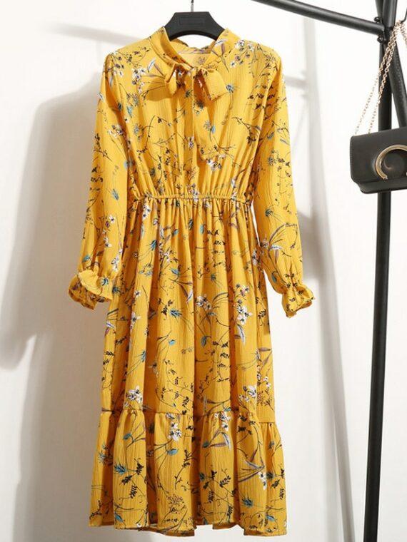 Musztardowa sukienka z wiązaniem pod szyją midi w kwiaty