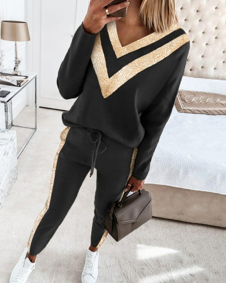 Damski czarny dres ze złotymi lampasami 1