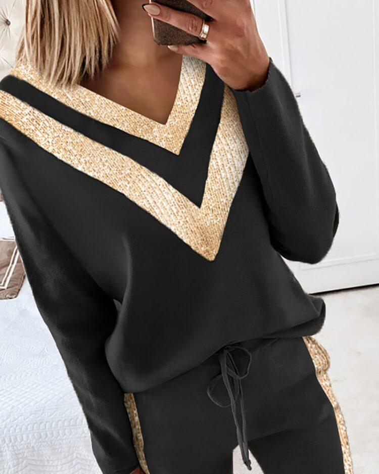 Damski czarny dres ze złotymi lampasami