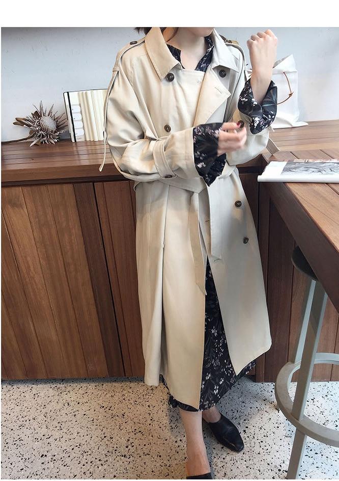 Luźny kremowy płaszcz damski trencz z paskiem 1